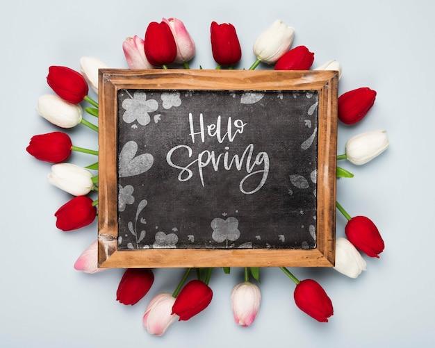Flat lay of blackboard with spring tulips