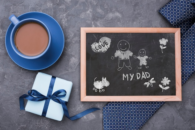 Flat lay of blackboard with tie and coffee for fathers day