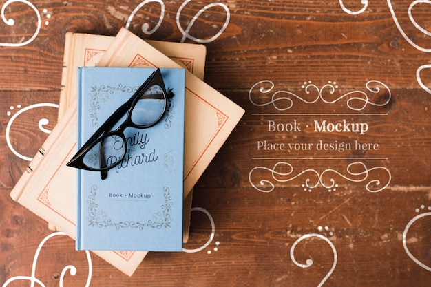 Flat lay of book with glasses on top mock-up