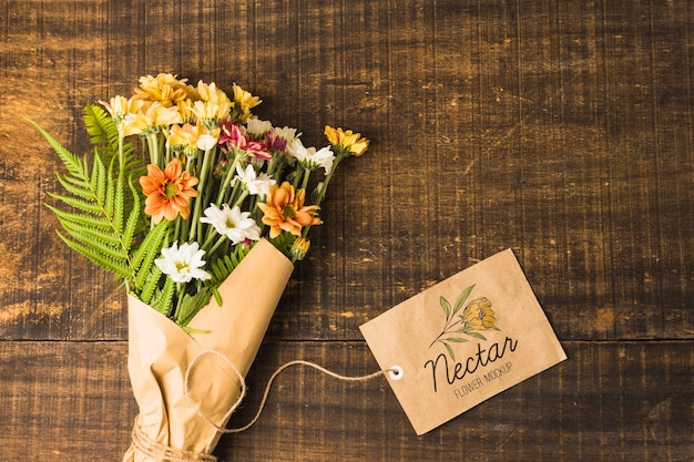 Flat lay bouquet of flowers with mock-up tag