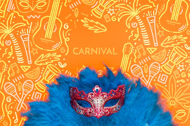 Flat lay of brazilian carnival mask with feathers