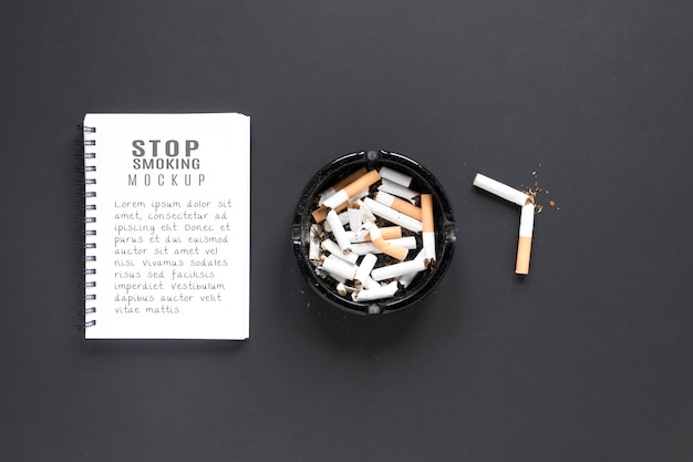 Flat lay broken cigarettes in ashtray