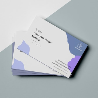 Flat lay of business card designs with braille writing