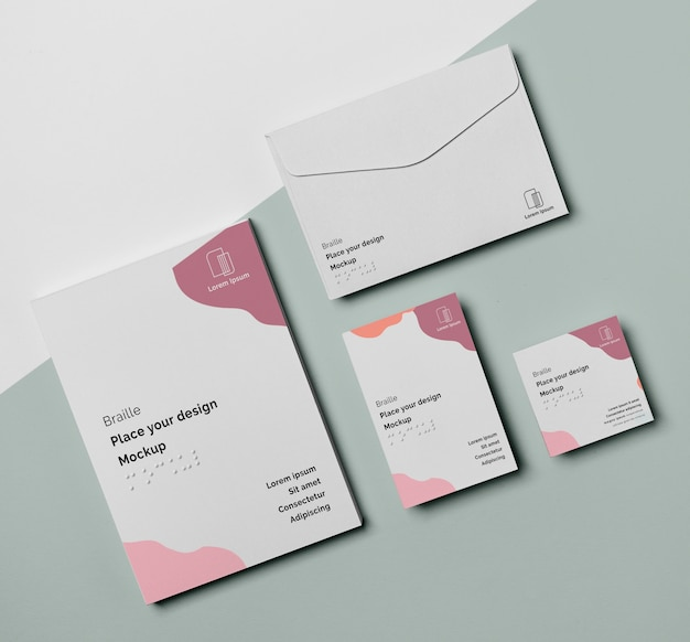 Flat lay of business card with braille and envelope