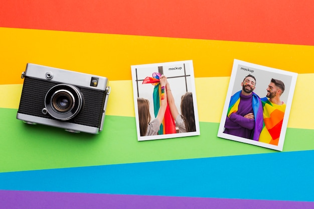 Flat lay of camera with pictures for pride