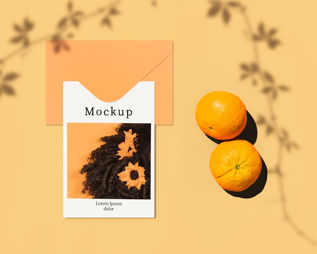 Flat lay of card with citrus and leaves shadow