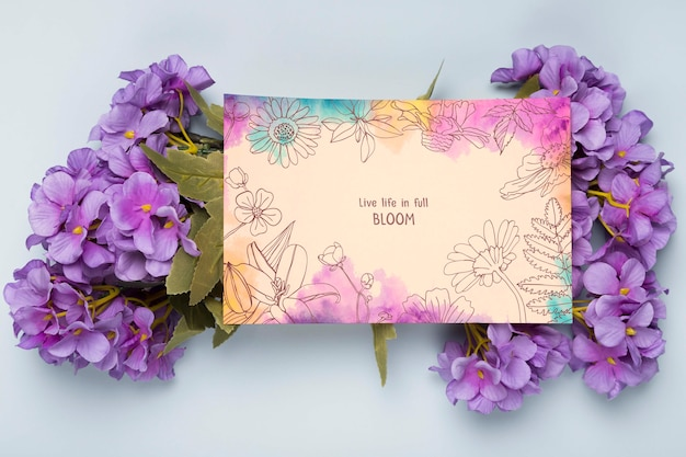 Flat lay of card with spring flowers