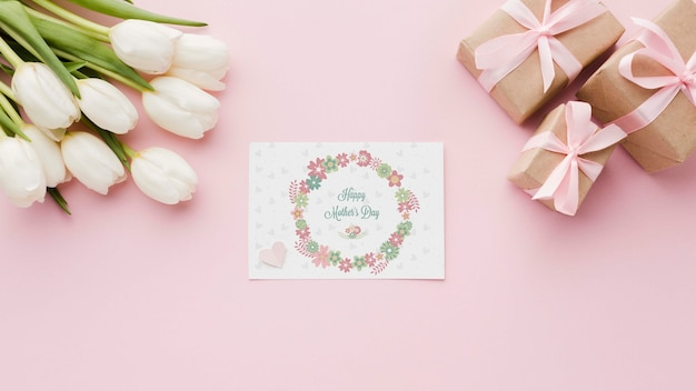 Flat lay of card with tulips and presents