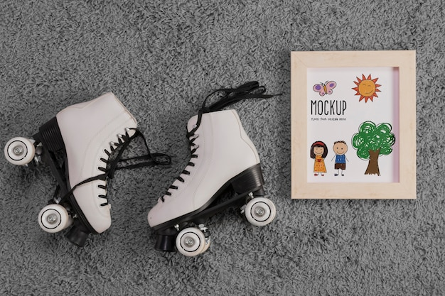 Flat lay of children roller skates with frame