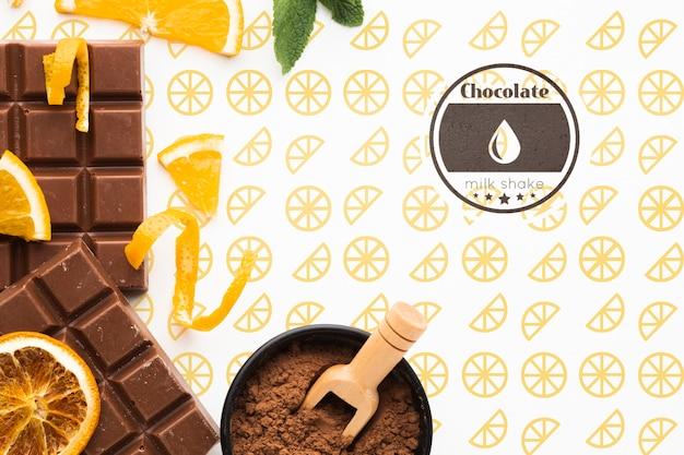 Flat lay chocolate with orange background mock-up