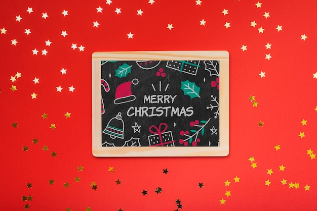 Flat lay of christmas concept chalkboard with red background