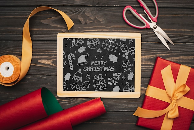 Flat lay  of christmas concept chalkboard on wooden table