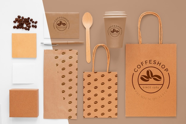Flat lay coffee beans and branding items
