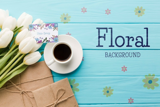 Flat lay of coffee cup with tulips and presents