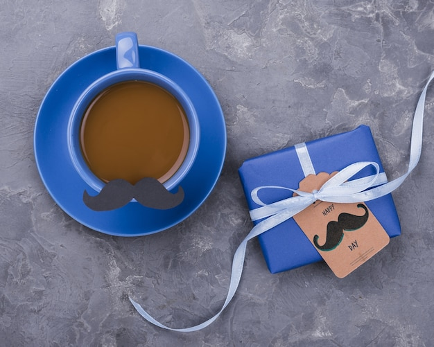 Flat lay of coffee with gift for fathers day