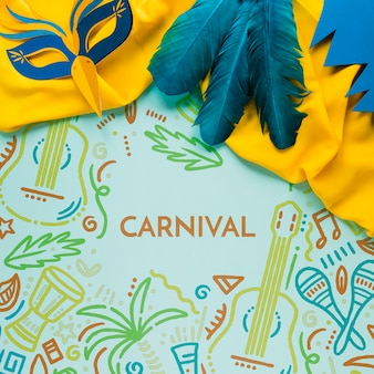Flat lay of colorful carnival feathers and mask