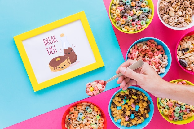 Flat lay of colorful cereals bowls and frame