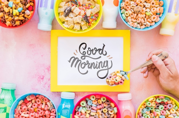 Flat lay of colorful cereals and frame on plain background
