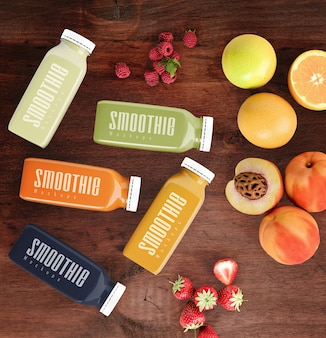 Flat lay colorful smoothies next to fruits mock-up