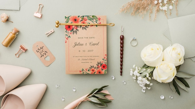 Flat lay composition of wedding elements with card mock-up