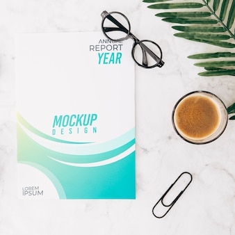 Flat lay cover mockup on workspace