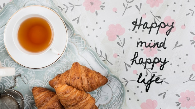 Flat lay croissants and cup of tea