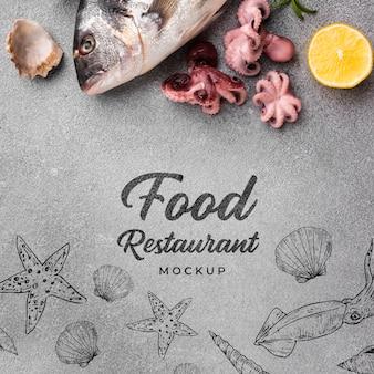 Disposizione dei frutti di mare deliziosi piatti laici con mock-up