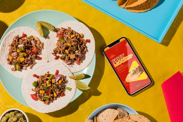 Flat lay delicious tacos on plate mock-up