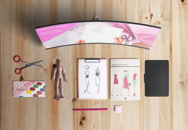 Flat lay of designer desk with acuarelas
