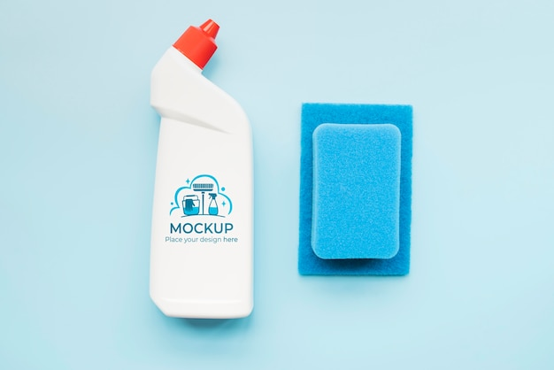 Flat lay detergent bottle and sponge