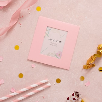 Flat lay of elegant birthday card with straws and ribbon