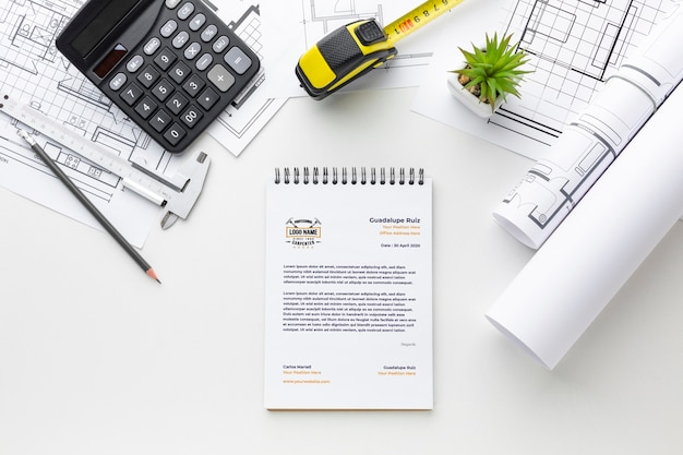 Flat lay engineering tools with notepad mock-up