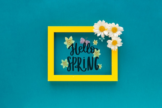 Flat lay frame mockup with spring flowers