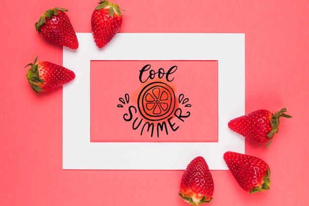 Flat lay frame mockup with strawberries