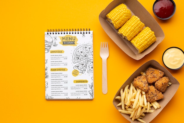 Flat lay free food delivery assortment with notepad mock-up