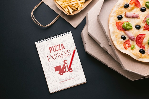 Flat lay free food service assortment with notepad mock-up