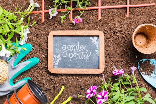 Flat lay gardening tools and wooden frame
