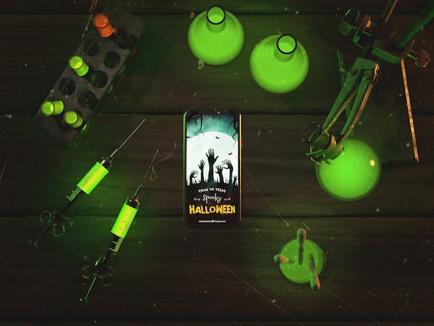 Flat lay halloween concept with smartphone