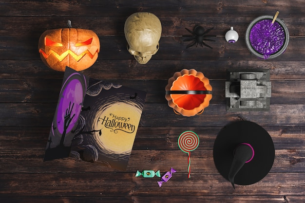 Flat lay of halloween elements on wooden background
