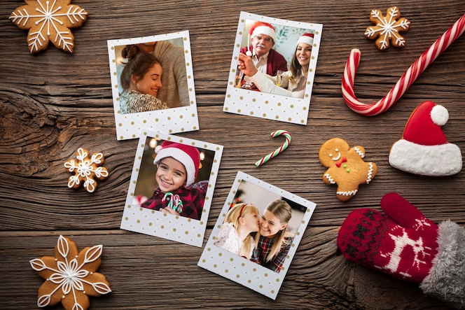 Flat lay happy family photos on wooden background