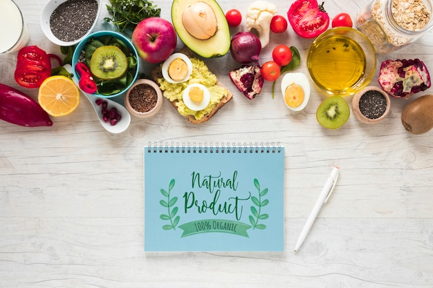 Flat lay of healthy food with notepad mockup