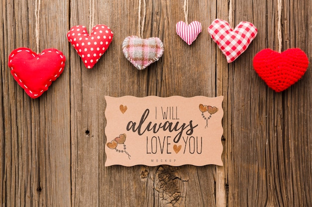 Flat lay hearts on wooden background