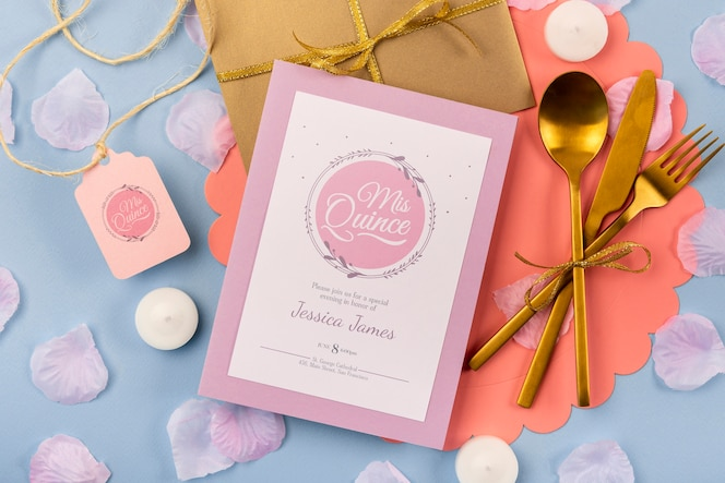 Flat lay invitation for sweet fifteen and golden cutlery