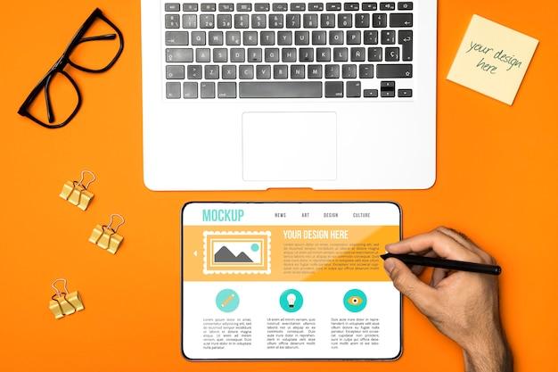 Flat lay laptop and tablet arrangement