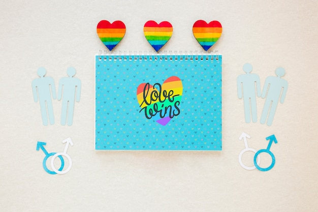 Flat lay lgbt pride composition with notepad template