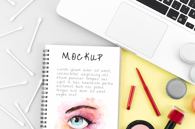 Flat lay make-up cosmetics arrangement with notepad mock-up