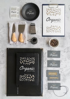 Flat lay of menu with utensils and grater