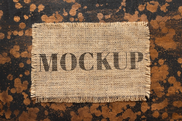 Flat lay of mock-up frame design from burlap