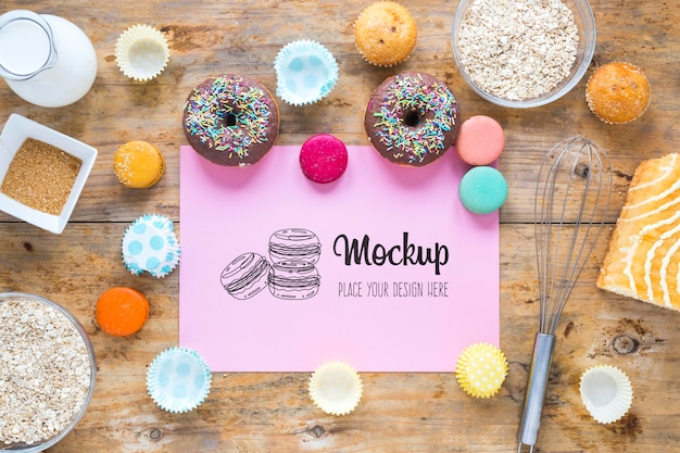 Flat lay mock-up with delicious doughnuts