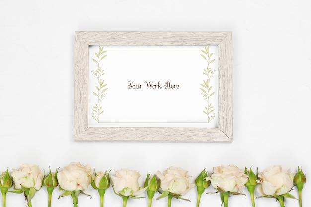 Flat lay mockup beige photo frame with flowers